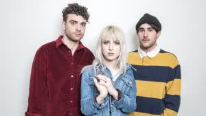 The members of Paramore (from left: Taylor York, Hayley Williams and Zac Farro) pair upbeat '80s sounds with bleak lyrics onAfter Laughter