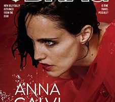 Anna Calvi featured on the cover of The Brag magazine, close-up on a red, wet background
