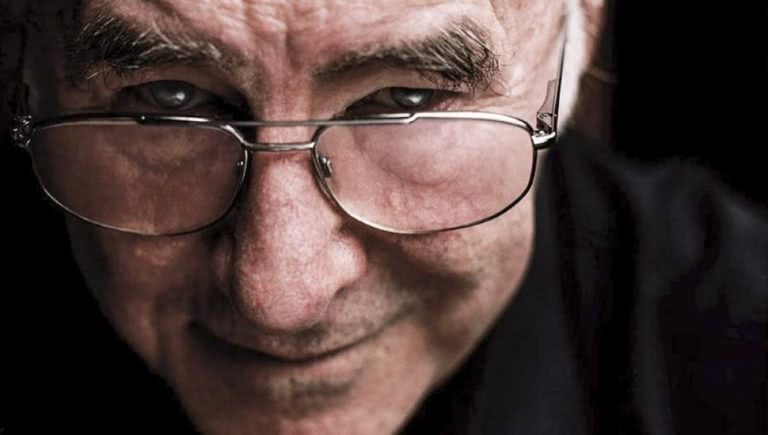 clive james black background