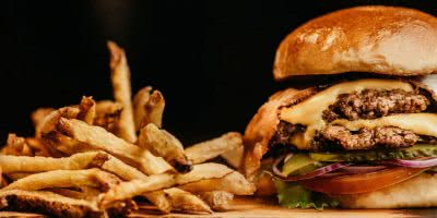 Photo of Junk Food Featuring a burger and fries
