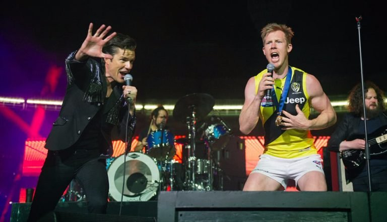 The Killers performing with Jack Riewoldt at yesterday's AFL Grand Final