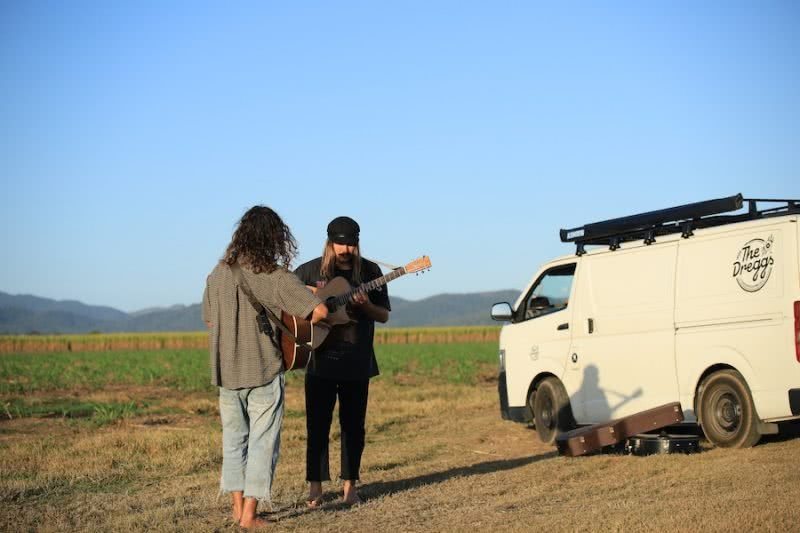 the dreggs playing guitar on grass