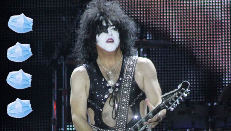 Kiss frontman Paul Stanley with face masks.