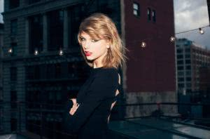 taylor swift ptess shot 1989 era black dress blonde short hair