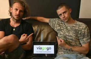 Members of The Rubens gesturing towards the logo for Viagogo