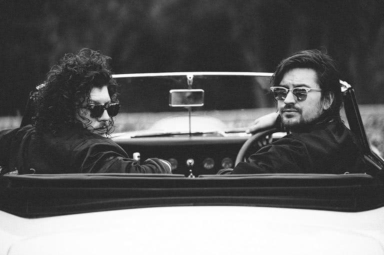 peking duk 2018 in car black and white