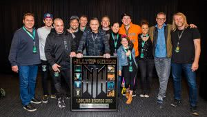 Image of the Hilltop Hoods celebrating their milestone of selling over a million Aussie records